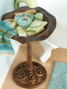 Birdbath to hold bath salts, soaps by tub