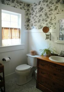 Powder room wallpaper and mirror