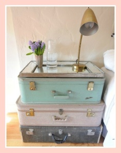 Stacked suitcases with mirror for sidetable
