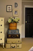 stacked suitcases with plant