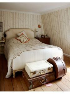 Vintage luggage at end of bed